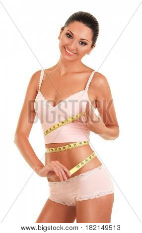 Happy pretty tanned woman with measure tape isolated on white background. Close up of sporty and beautiful female body. Healthy lifestyle, dieting, fitness, weight loss concept