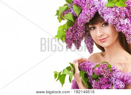 Young woman with spring flowers on white background. Care for beautiful woman skin. Cosmetology, spa therapy and makeup at beauty salon. Portrait of woman face with lilac flowers. Spring beauty