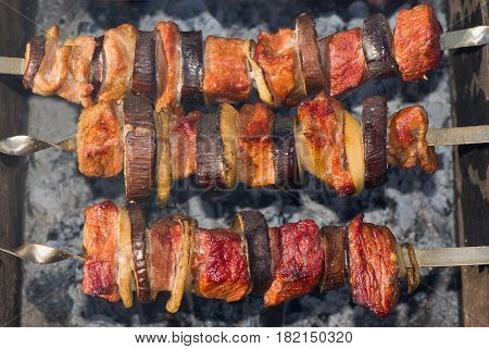 Shashlik - Georgian national meal with meat and vegetables cooked on smouldering carbons.