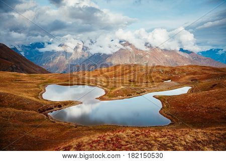 A look at the main Caucasus ridge and Koruldi lake. Picturesque day and gorgeous scene. Location Mestia, Upper Svaneti, Georgia country, Europe. Unique place on earth. Explore the world's beauty.