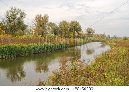 Autumnal Ukranian landscape with river in an overcast day.