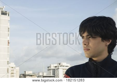 Serious Hispanic man in urban setting