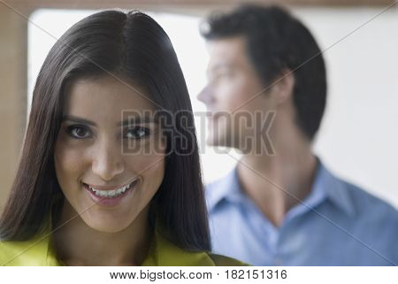 Confident Hispanic woman smiling