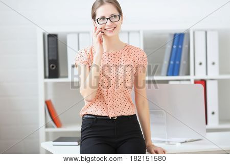 Business Woman Talking On The Phone At Work In The Office
