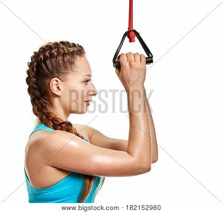 Portrait of young beautiful healthy woman doing exercise with expander