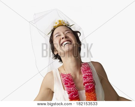Asian woman in wedding dress and lei