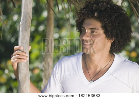 African man standing in shade