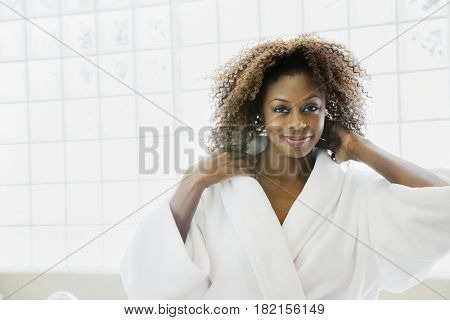 Confident African woman in bathrobe