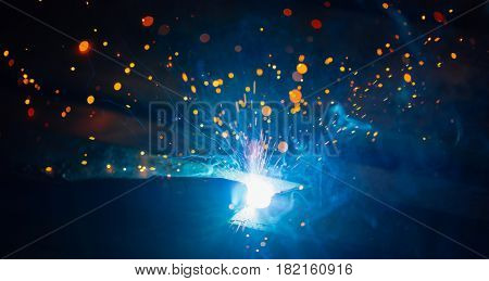 artistic welding sparks light, industrial background