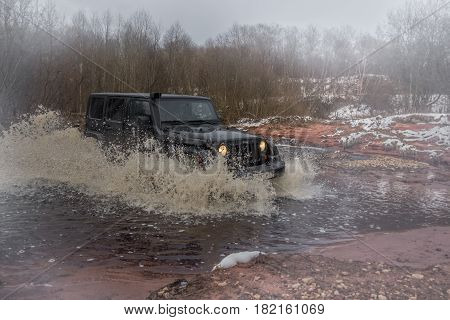 Leningrad region, Russia - April 16, 2016. Jeep Wrangler on the shore of the river Wrangler is a compact SUV produced by Chrysler