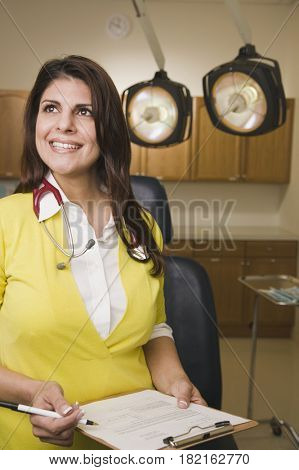 Mixed race doctor in doctor's office