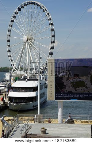 OXON HILL, MD - APR 16: The Capital Wheel at National Harbor in Oxon Hill, Maryland, as seen on April 16, 2017. It is 175 feet tall and opened on May 23, 2014.