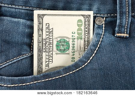 A one hundred dollar note in the front pocket of denim trousers