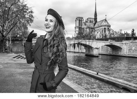 Traveller Woman On Embankment In Paris Enjoying Promenade