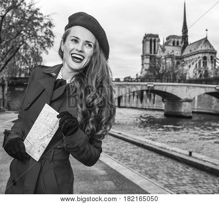 Tourist Woman On Embankment Near Notre Dame De Paris With Map
