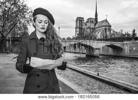 Traveller Woman Near Notre Dame De Paris In Paris Looking At Map
