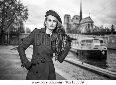 Modern Woman Standing On Embankment In Paris, France