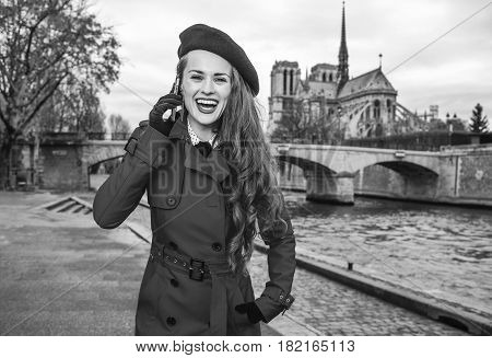 Woman On Embankment In Paris, France Talking On Cell Phone