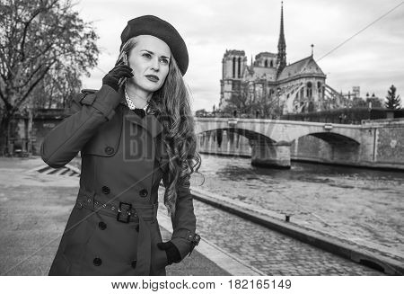 Traveller Woman On Embankment In Paris Talking On A Smartphone