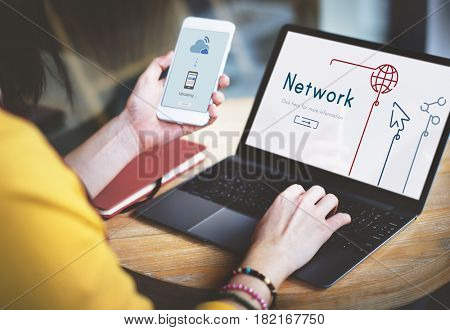 Woman connected with global communications network by laptop