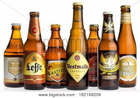 GRONINGEN, NETHERLANDS - APRIL 15, 2017: Collection of Chimay, Leffe, Kasteel, Val-Dieu, Westmalle, Grimbergen and Anvers tripel beers isolated on a white background