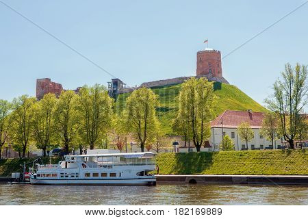 Vilnius Lithuania - May 9 2015: Vilnius city centre near the river Neris with its main landmark Gediminas castle.
