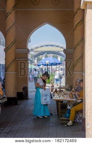 Woman Selling Kurut, Dried Cheese Balls