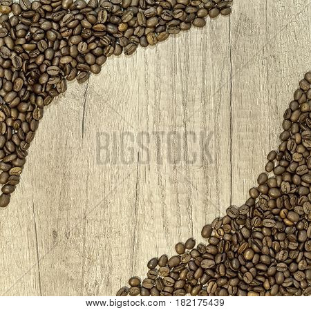 Coffee beans on wooden table, frame coffee beans