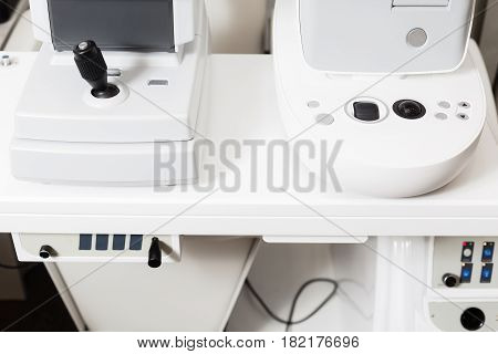 Close up of professional eye testing equipment. Modern eye testing device standing in the lab. Tonometer in ophthalmologist's office.