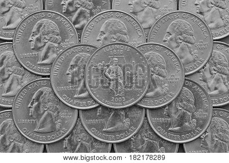 Illinois State and coins of USA. Pile of the US quarter coins with George Washington and on the top a quarter of Illinois State.