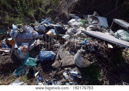 Ukrainian nature in spring.Environmental contamination. Illegal junk dump.  April 17, 2017.Near Kiev, Ukraine