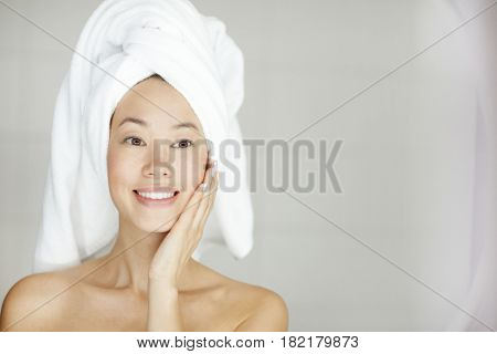 Perfect girl touching her clean face