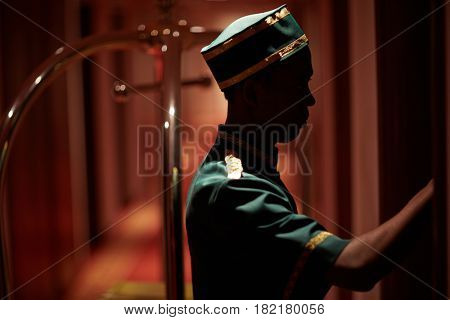 Hotel staff knocking on one of hotel doors