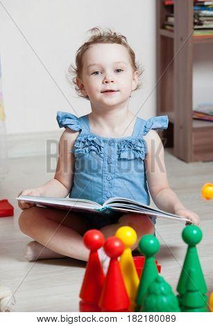 beautiful girl read book in room
