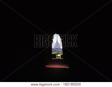 ROME ITALY - APRIL 10 2017: View of St. Peter's dome through the keyhole on the gate to the headquarters of the Knights of Malta on Rome's Aventine Hill in Rome Italy on April 10 2017.