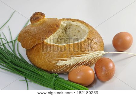 empty bread bowl with a lid on white background