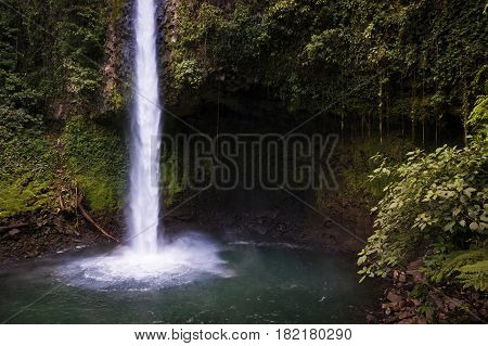 View of the La Fortuna Waterfall in Costa Rica Central America; Concept for travel in Costa Rica