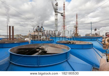 Chemical plant for production of ammonia and nitrogen fertilization on day time. Cooling tower with fan blades close-up