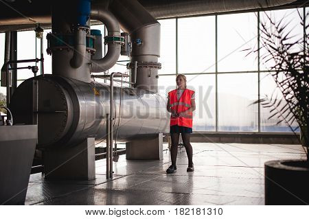 Female Worker On Beer Factory. Portrait Woman In Robe, Standing On Background Line Food Production,