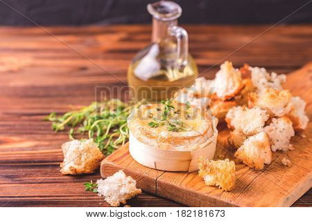 French Baked Camembert Cheese With Thyme And Baguette Bread
