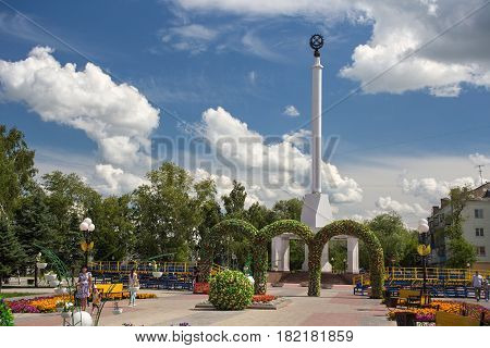 PETROPAVL, KAZAKHSTAN - JULY 24, 2015: Stela of Independence of Kazakhstan and city festive decorations. Petropavl is a city in northern Kazakhstan close to the border with Russia.
