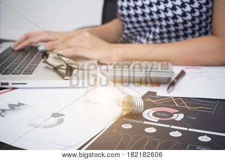 Business women working on desk office with light bulb. concept of new ideas with innovation and creativity.