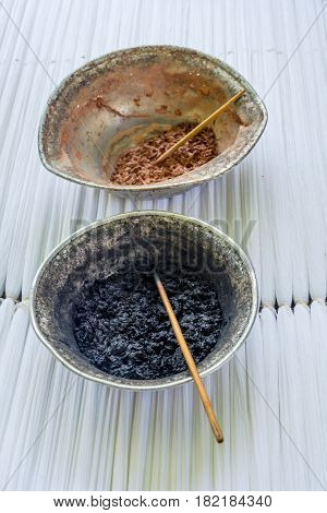 Natural dyes and pigments for silk coloring and fabric production with traditional Uzbek patterns Uzbekistan