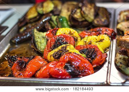 Beautiful green yellow and red grilled roasted bell pepper background. grilled vegetables on a grill close up