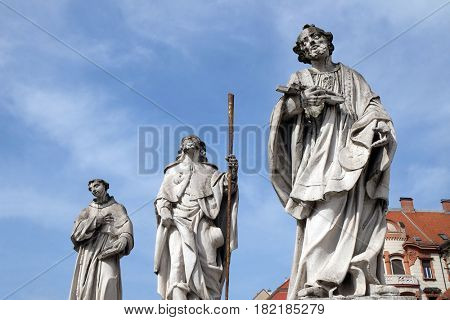 MARIBOR, SLOVENIA - APRIL 03: Saints Anthony of Padua, Roch and Francis Xavier statue, Plague column at Main Square of the city of Maribor in Slovenia. Historical religious sculpture, April 03, 2016.