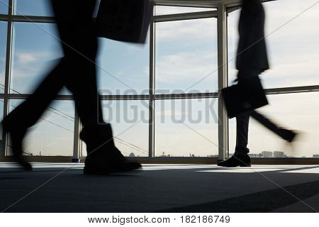 Business staff hurrying for work in office