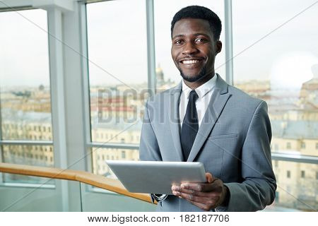 Successful banker with touchpad working online