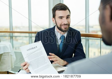 Confident employer explaining terms of contract to businsess partner or candidate for vacancy