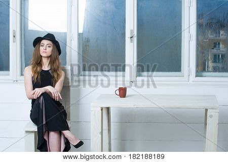 Pretty Girl In Hat And Dress Sitting On Wooden Chair