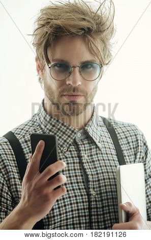Handsome Man In Eyeglasses With Smartphone And Laptop Computer